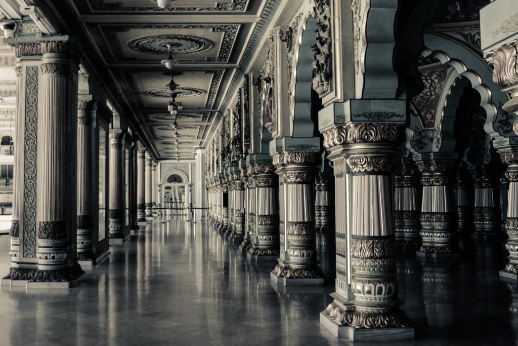 A marble hallway with intricate columns