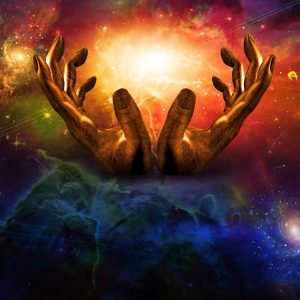 Two hands holding a galaxy between them